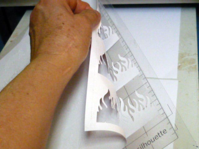 Peeling cut cardstock off the adhesive mat
