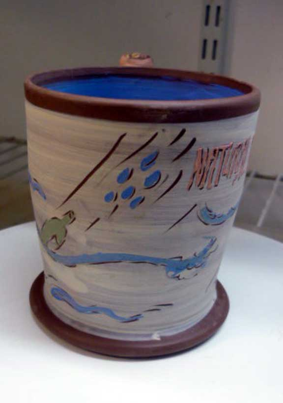 Arbuckle terracotta cup w slip on leatherhard clay w Tyvek stencil images. Greenware. Natural Disaster: Flood.