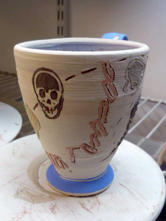 Arbuckle terracotta cup with slip on leatherhard clay w Tyvek stencils and sgraffito. Natural Distaster: Tornado. Greenware.