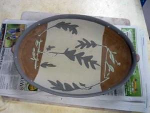 Greenware serving platter w/slip decoration.